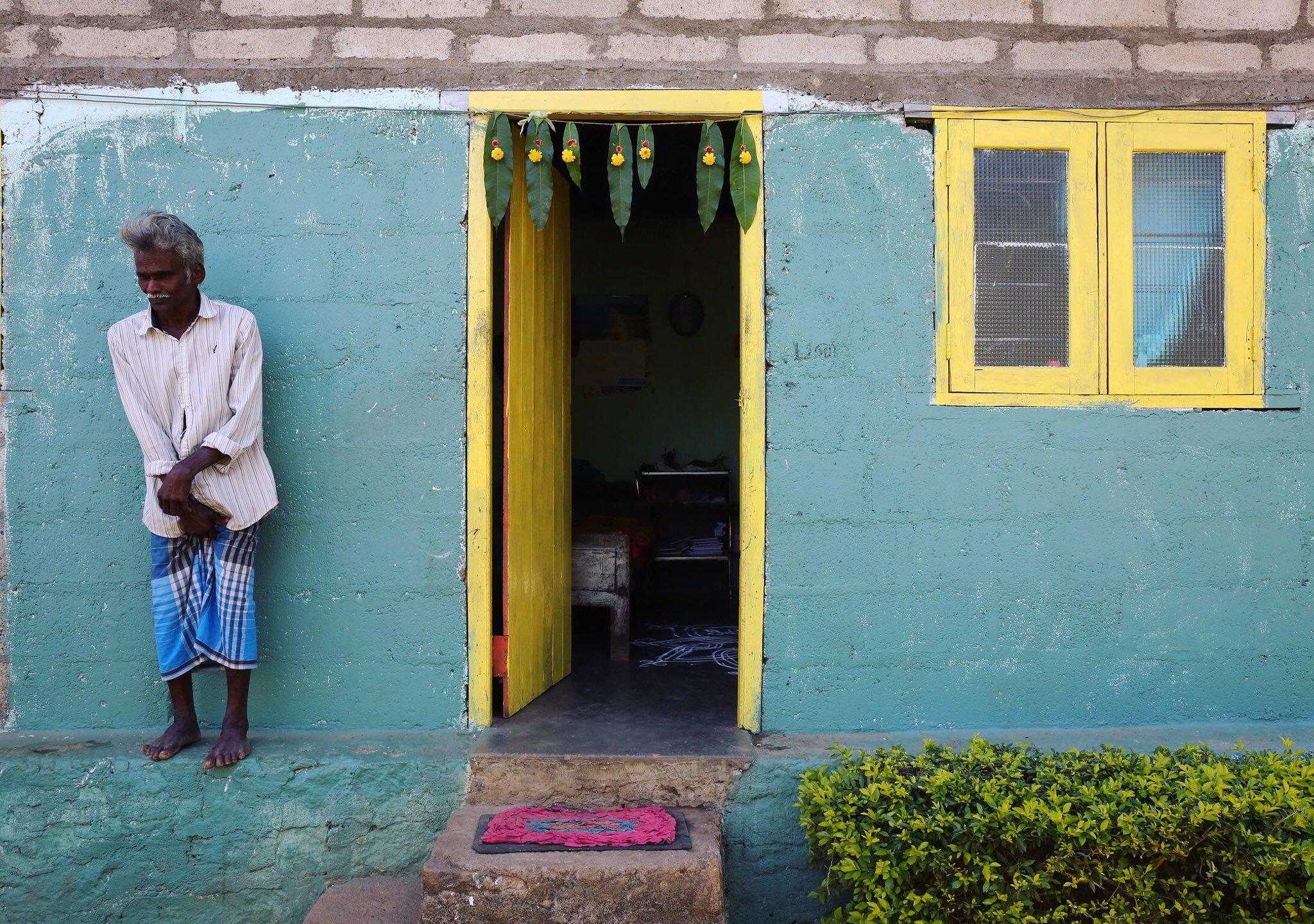 A Tamil man stands outside his home at Amba Estate. Ambadandegama Valley, Sri Lanka