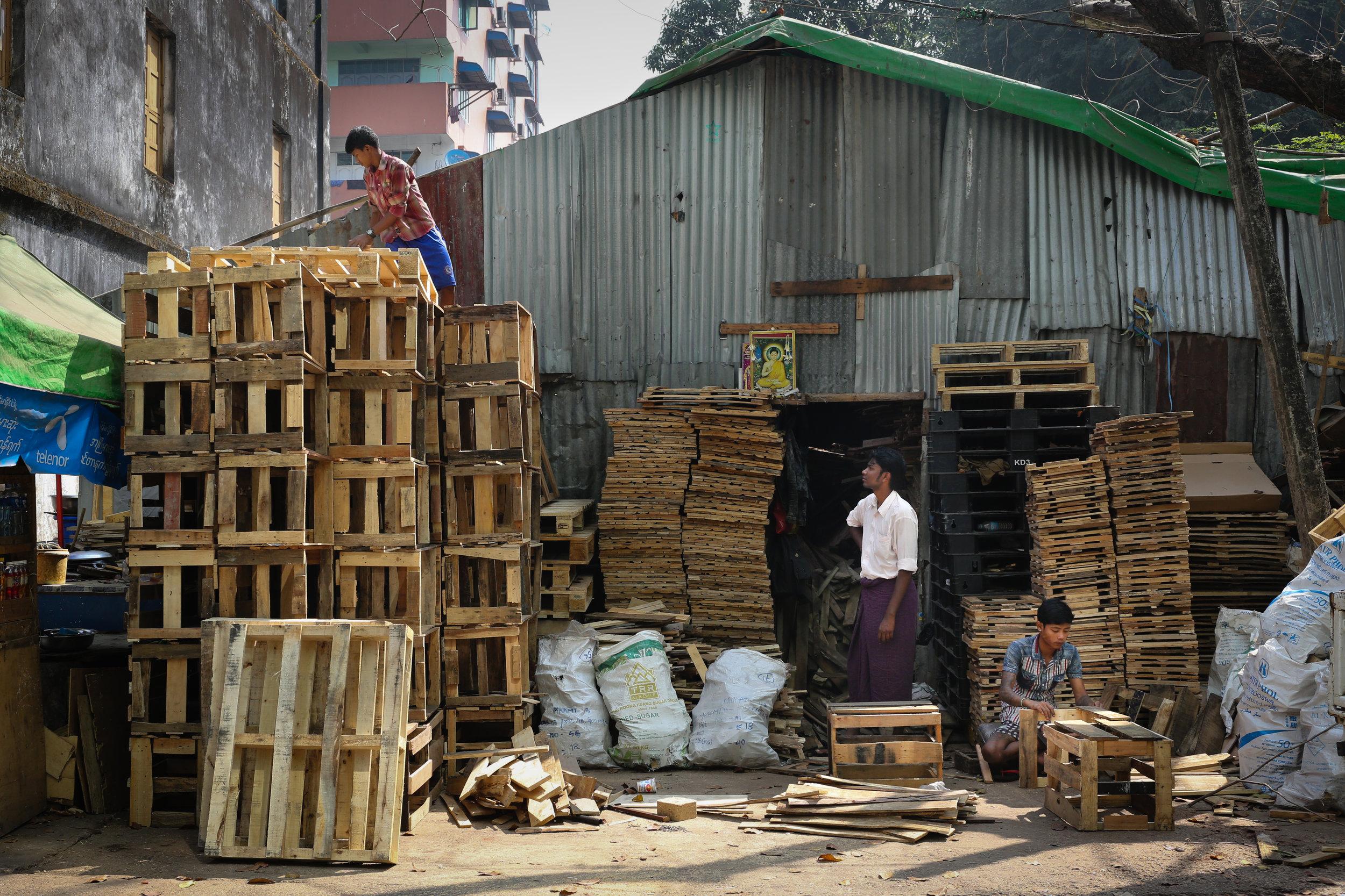 Pallet builders on 54th St. Yangon, Myanmar