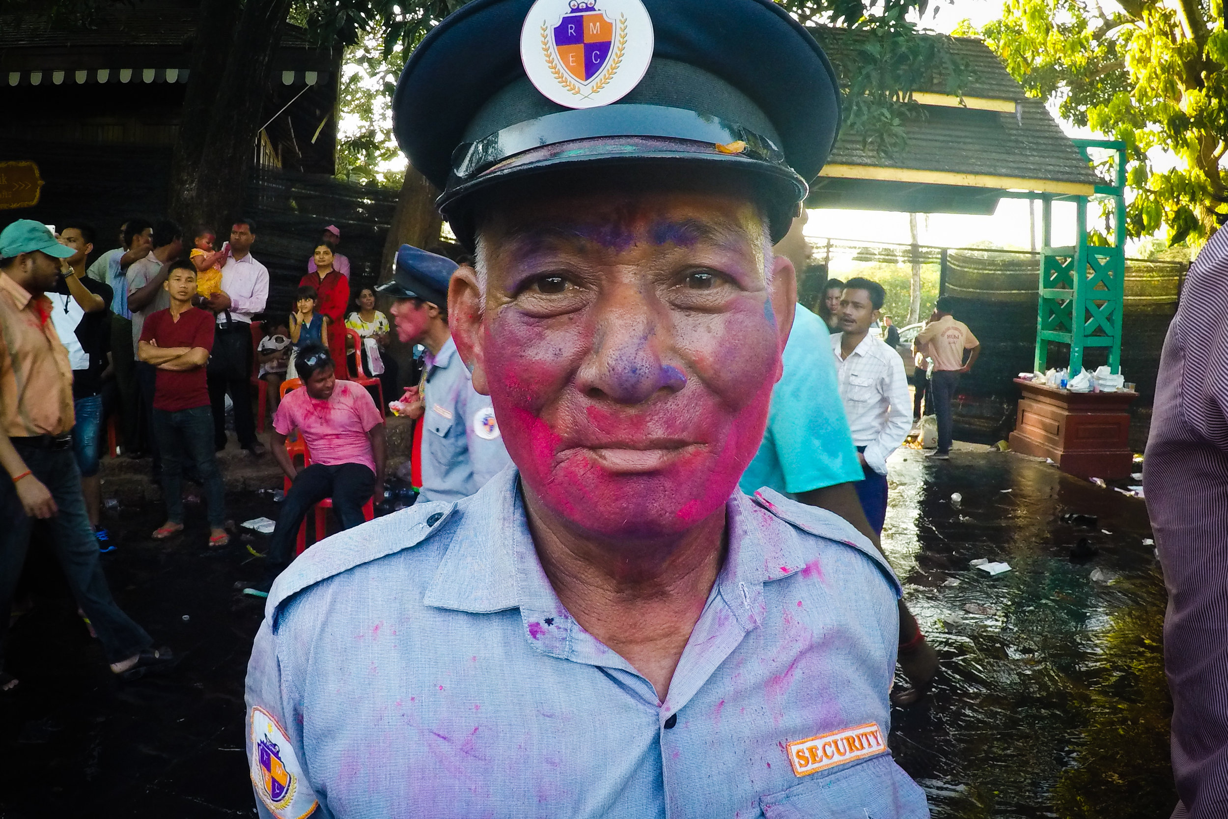 Even the security guards weren't safe from paint at the 2017 Holi celebration in Yangon. Shot using a waterproof GoPro Hero 4. Kandawgyi Lake, Yangon.
