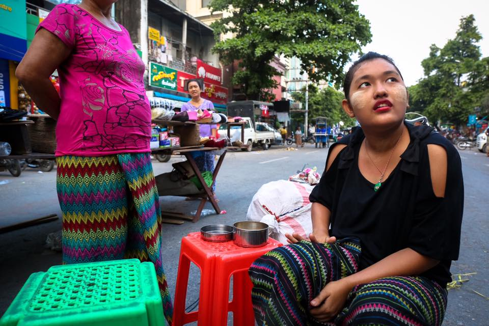 Street vendors discuss the new market opening in Mandalay. They said they would never choose to leave their current location, as it's busier and more central to town.