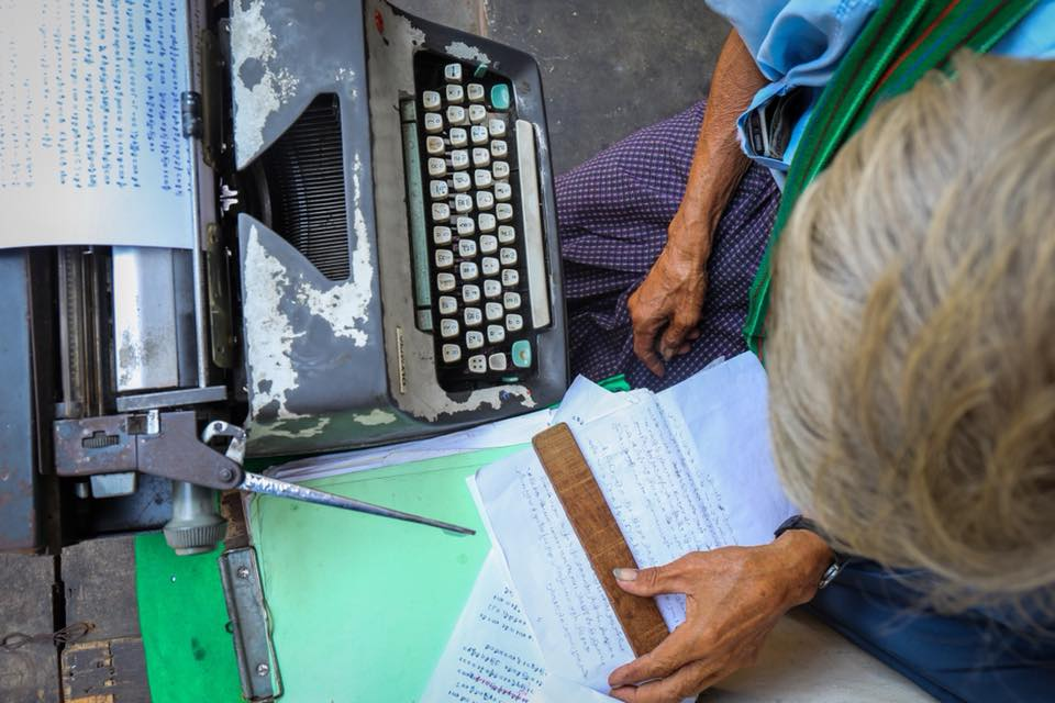 Typist Aung Myint works at his typewriter in downtown Yangon. Feb 2018.