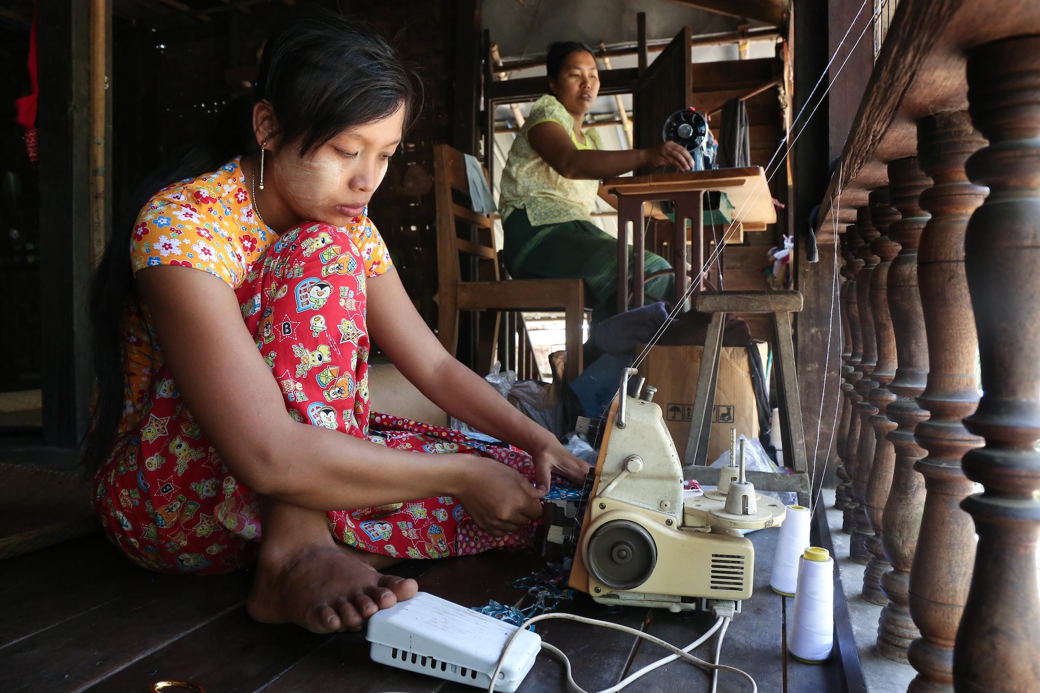 Women sew reusable menstrual panties. March 2018