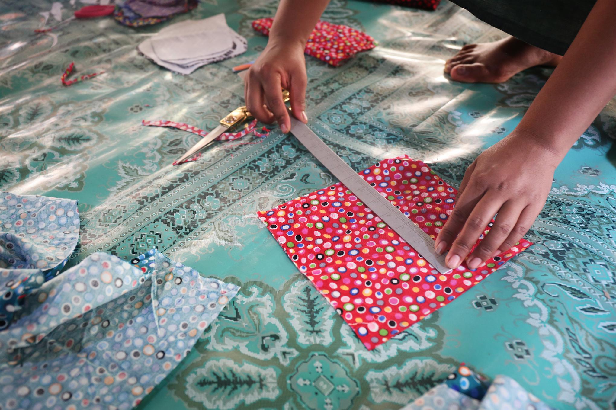 Women sew reusable menstrual pads. March 2018