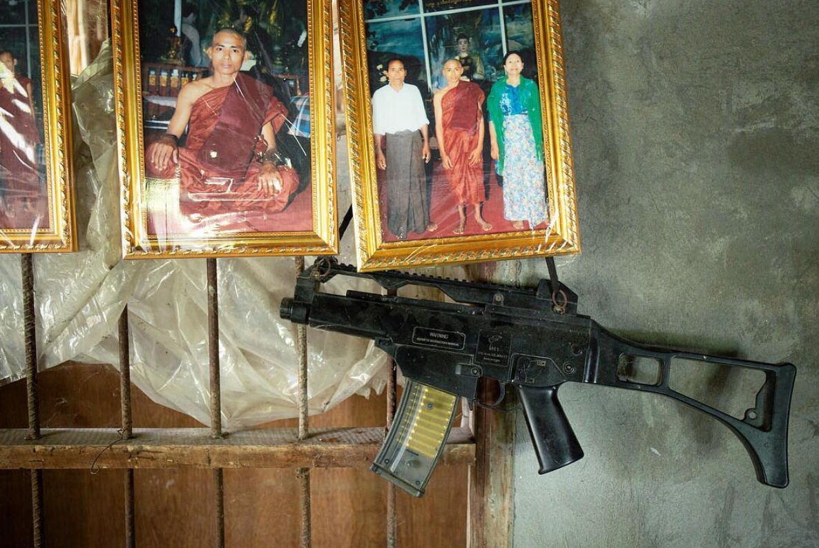 A gun hangs in the home of a farmer in Irrawaddy Division, Myanmar.