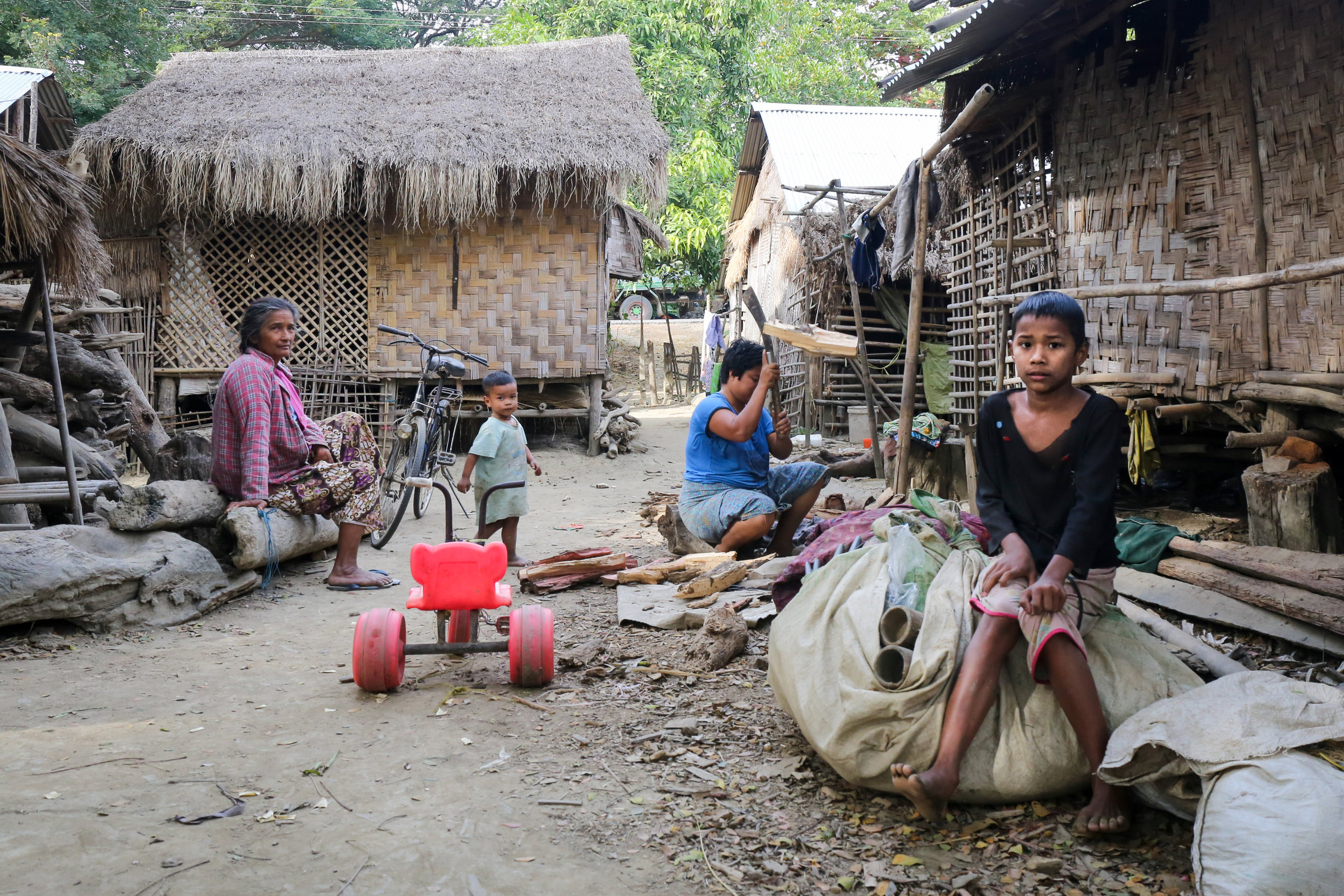 An overcrowded village along the Irrawaddy. Sand mining has contributed to bank erosion, causing coastal villages to slide into the river, with neighboring villages absorbing those displaced.