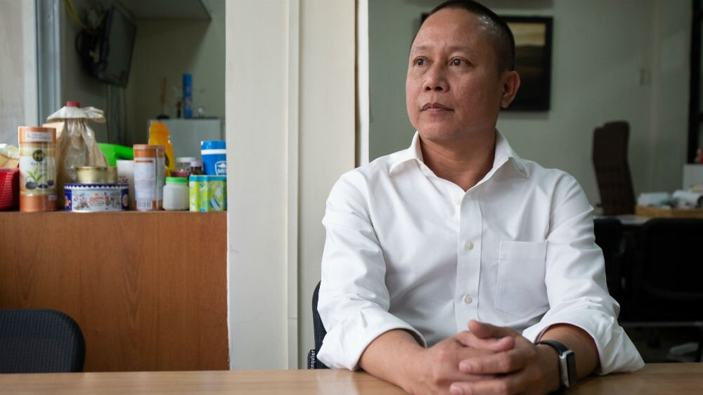 Sonny Swe sits in his office in Yangon. A former political prisoner, Sonny Swe says he suffers from PTSD.