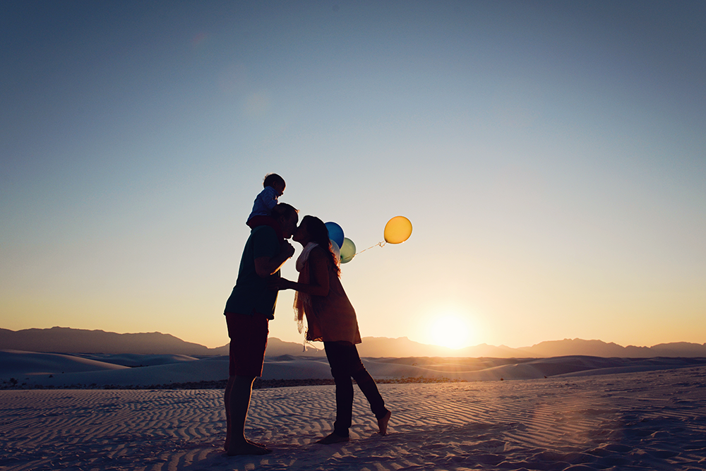 family-sunset-silhouette-beach-sand-kim