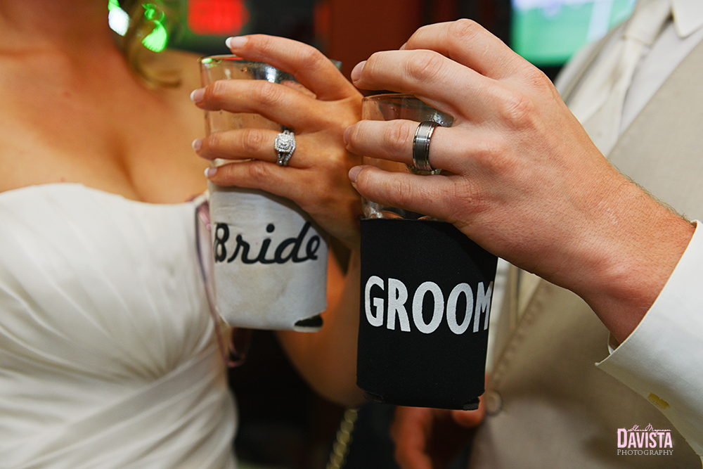 bride and groom coozie and wedding bands