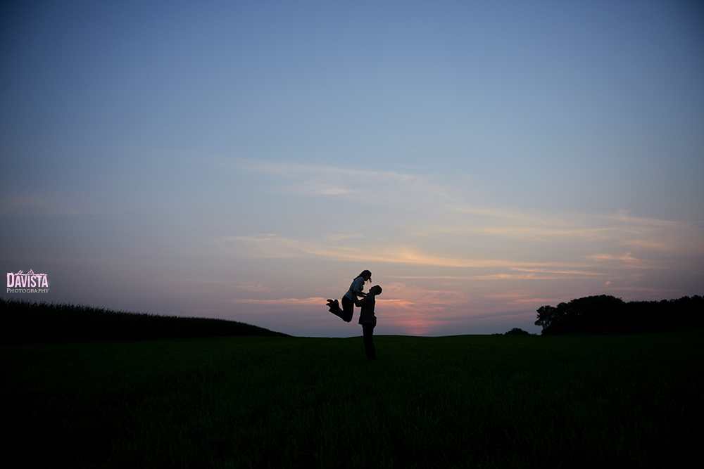 silhouette of couple in a field