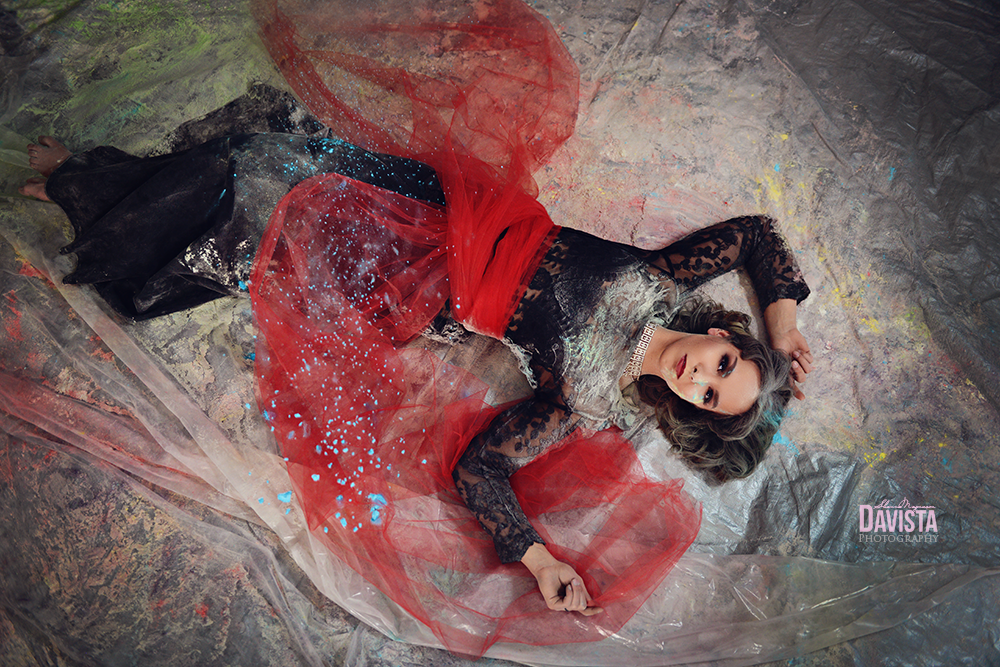 gorgeous beauty in tulle skirt and holi powder photography