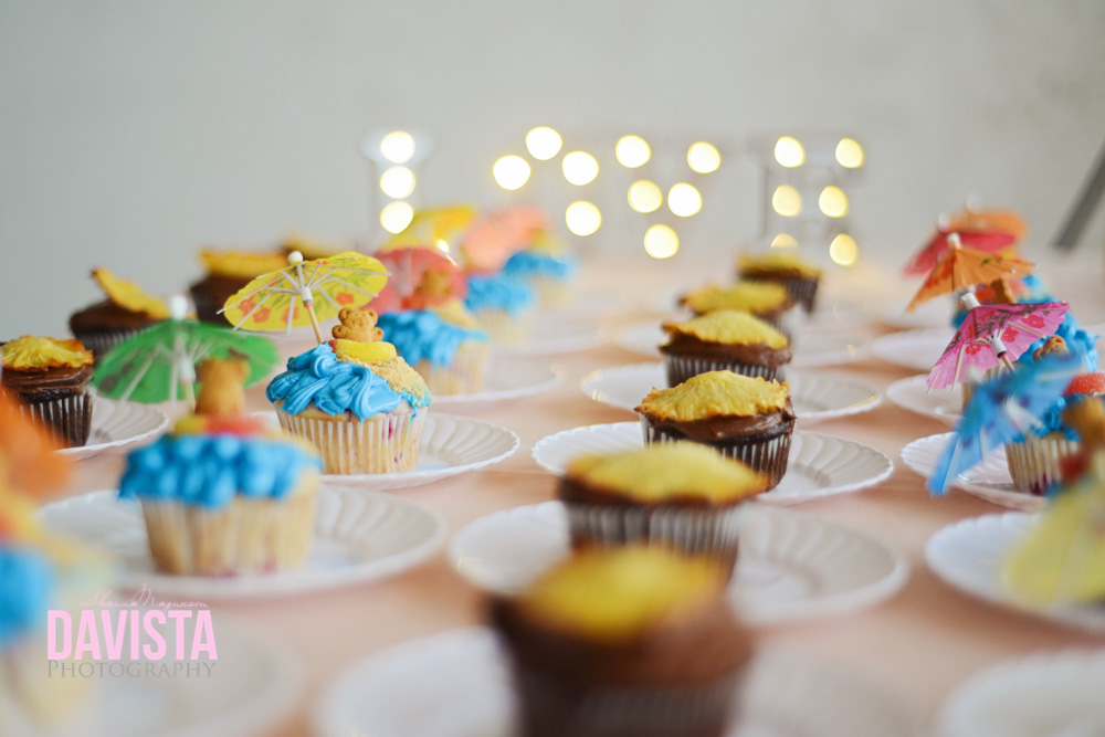 adorable dessert table with love and decorated cupcakes