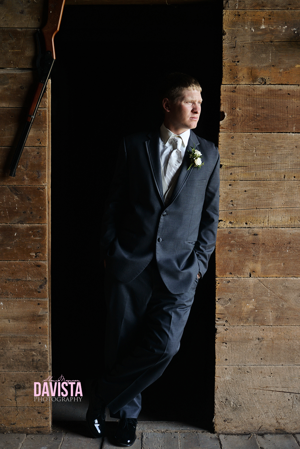 GQ groom portraits handsome in barn