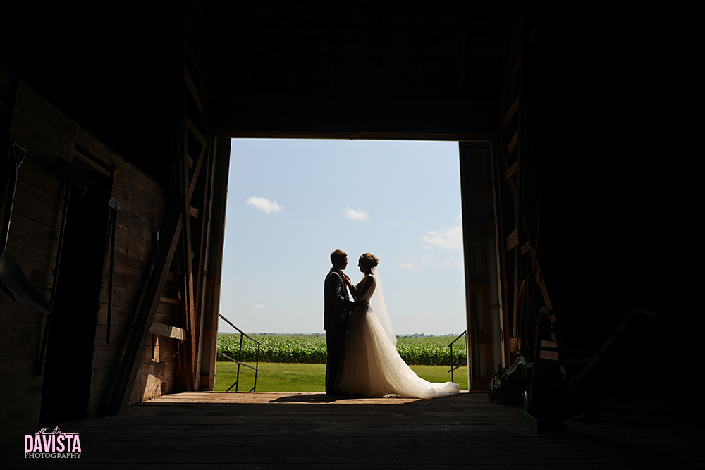 silhouette in barn on wedding day