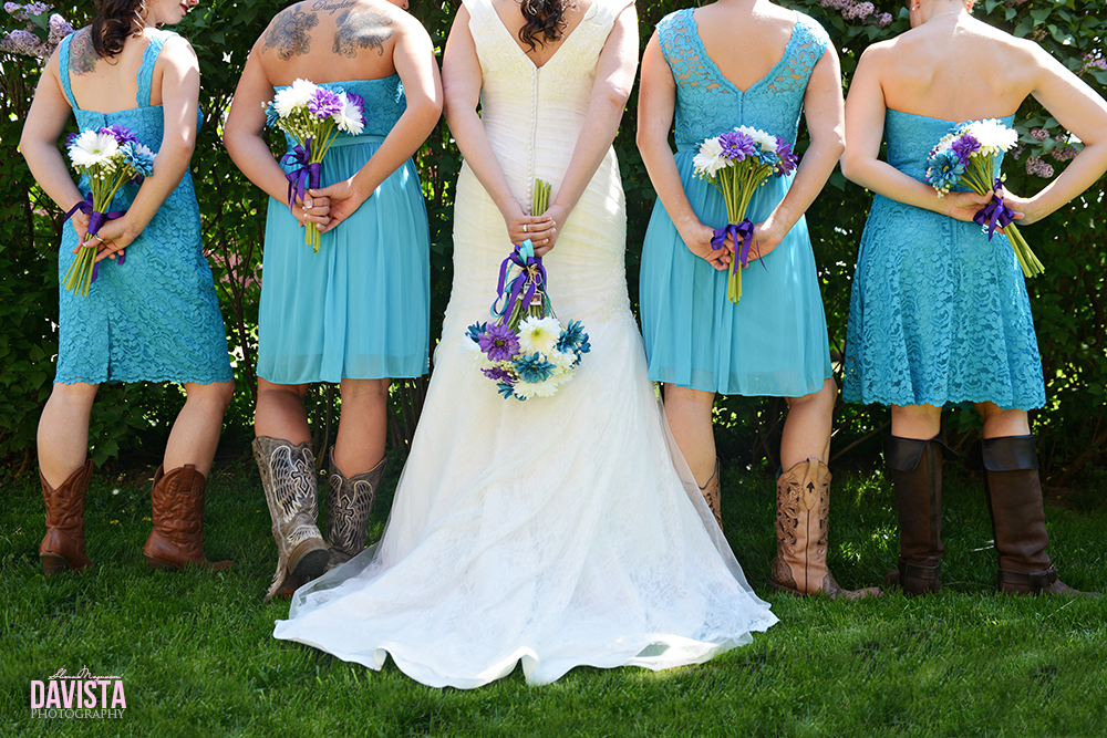 bridesmaids and their flowers and cowgirl boots