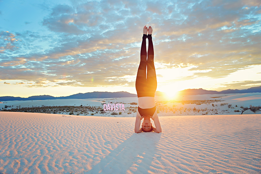 yogi headstand at sunset mediatation