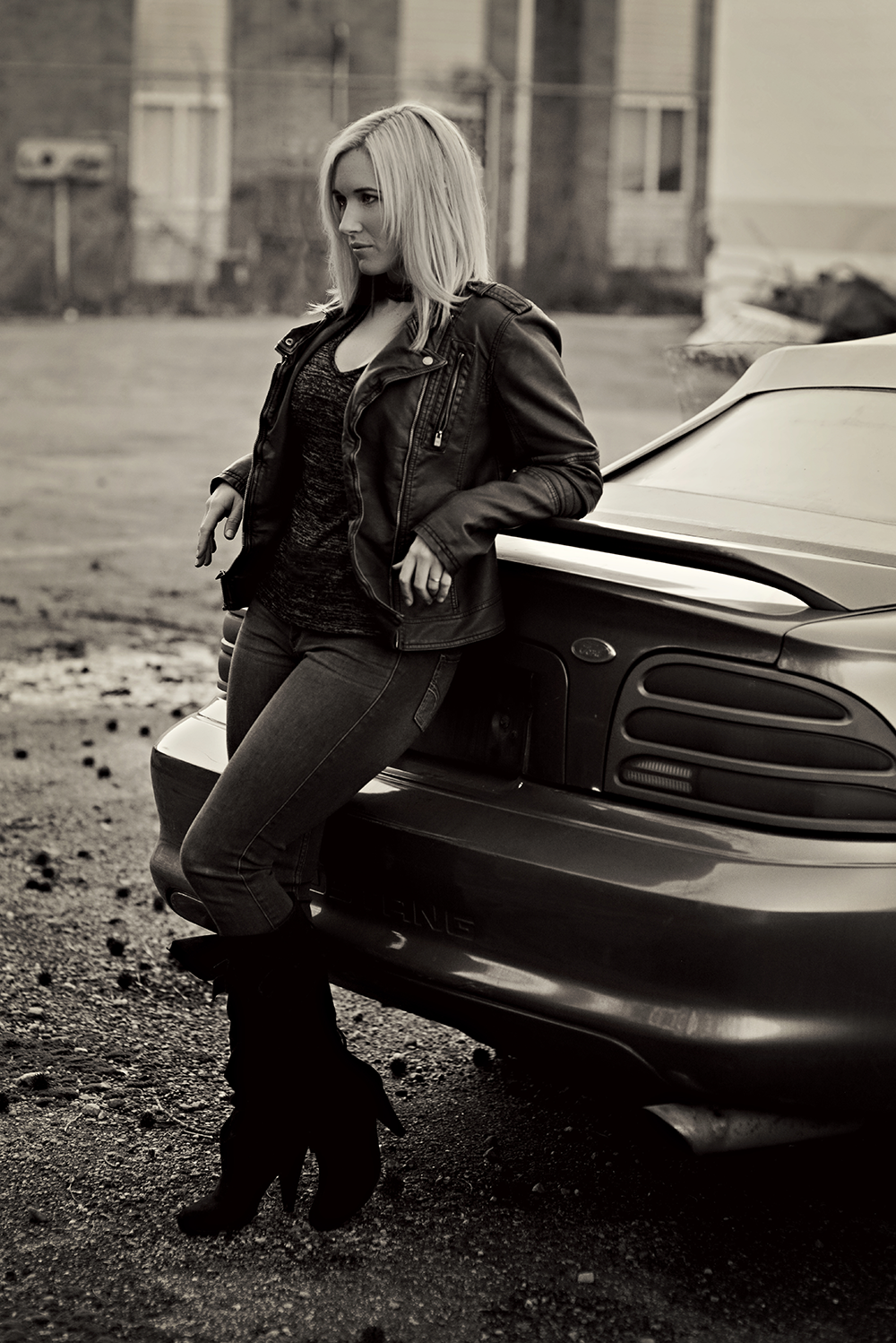 a girl and her Ford Mustang car
