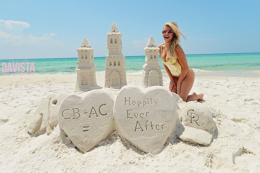 gorgeous bride at her beach bachelorette party and sandcastle