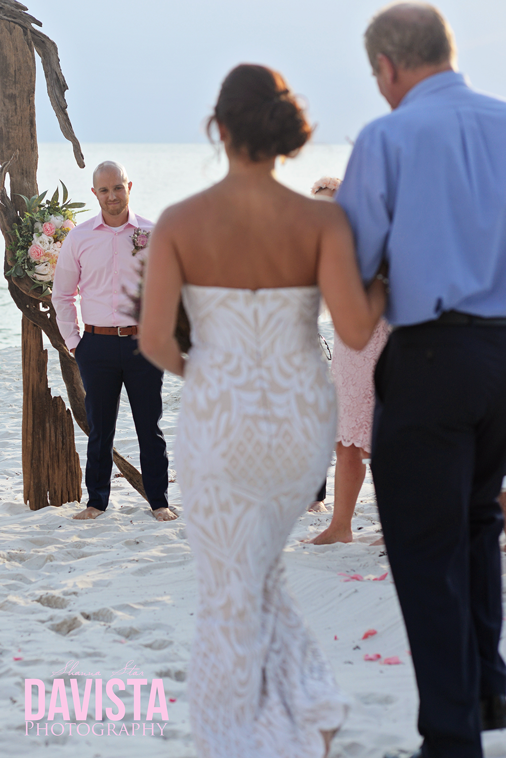 grooms first look on the beach