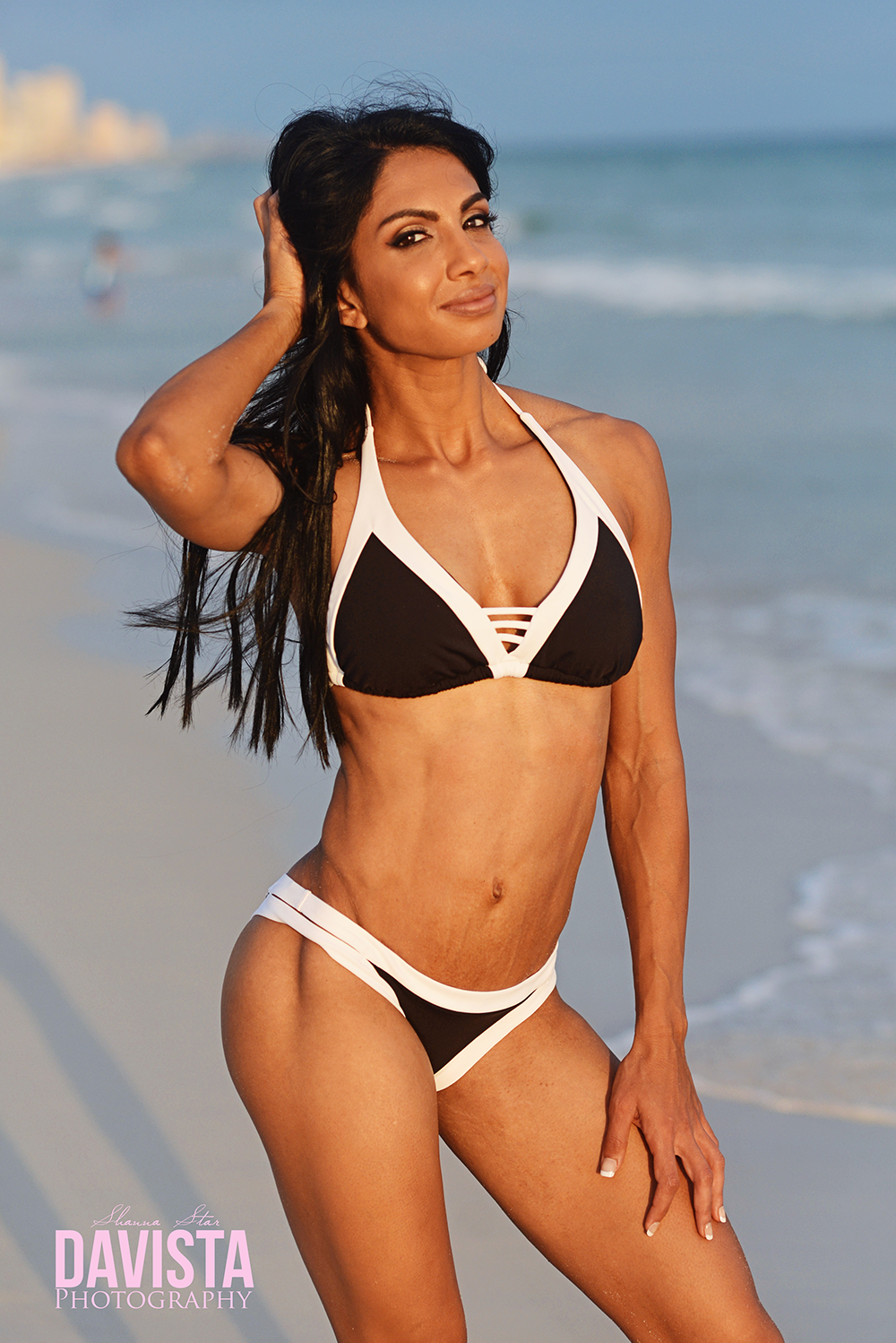 bikini competitor beach photo shoot
