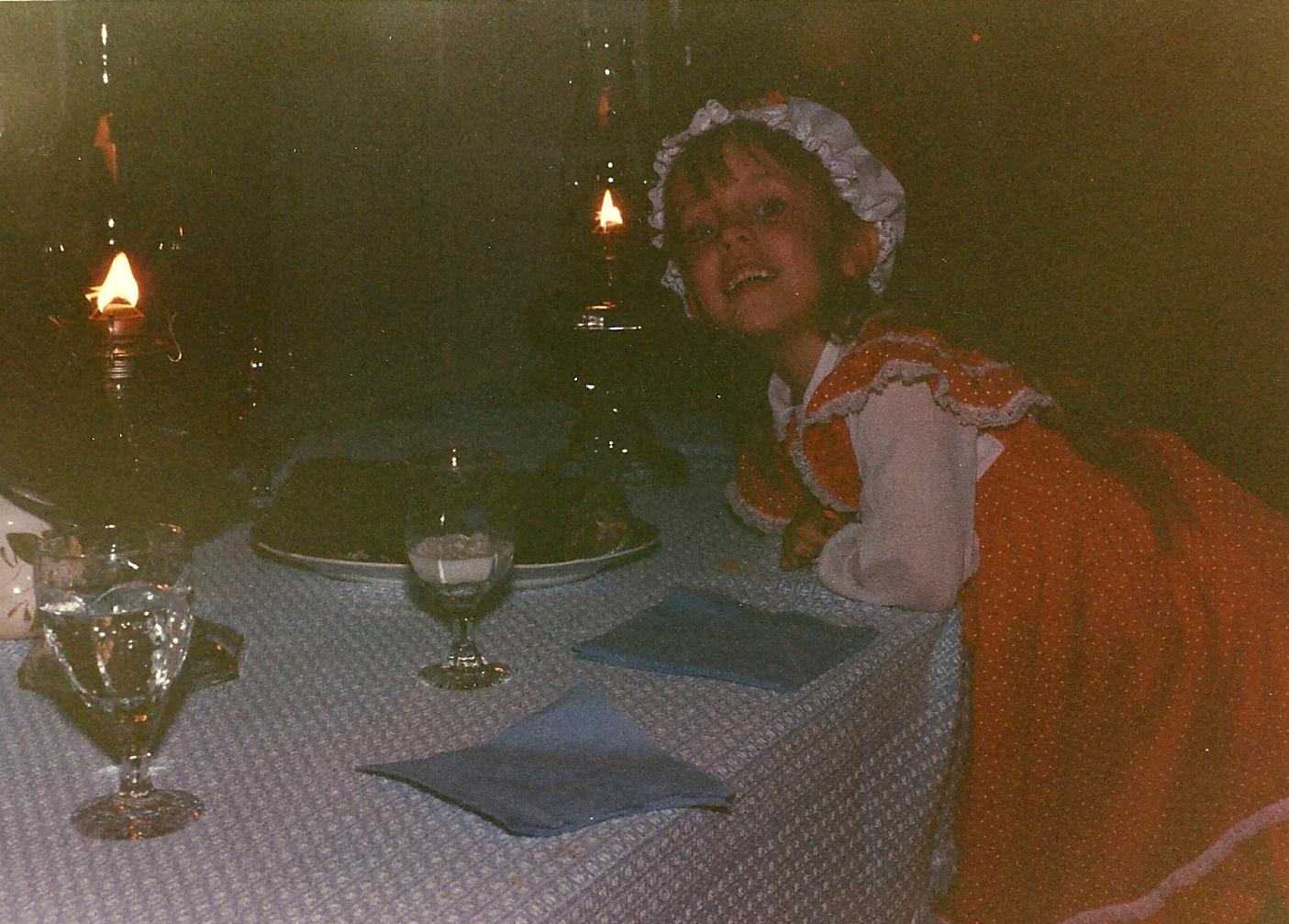 A young me, proudly posing before our dimly-lit colonial dinner table. Apparently, they pulled out all the stops in George Washington's day with blue paper napkins.