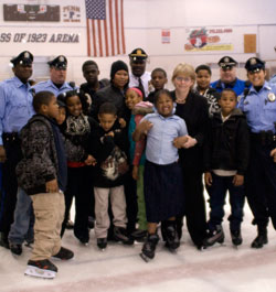 Maureen  receiving an award from the Police Athletic League , which serves more than 26,000 kids across Philadelphia.