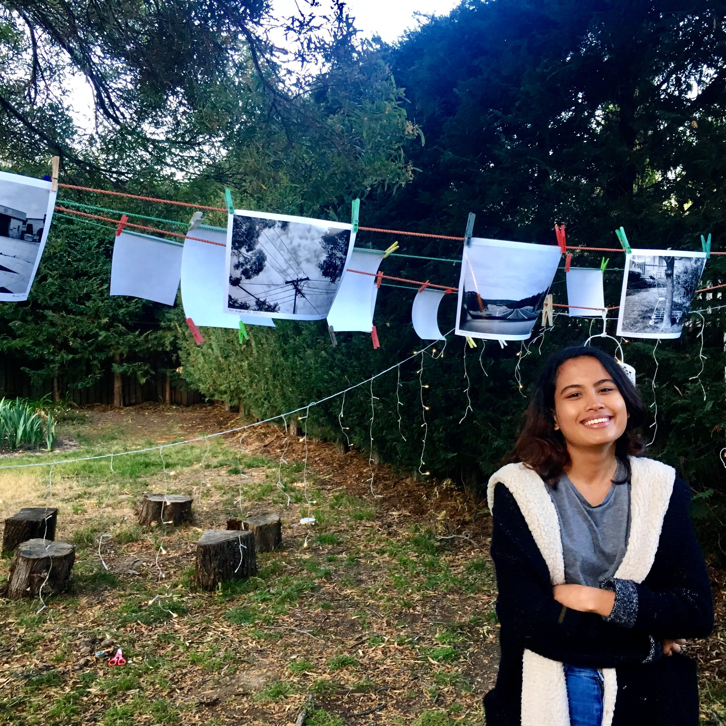 Photographer Aishah Kenton with some of her black and white archival pigment prints, which were on display and sale for $10 each.