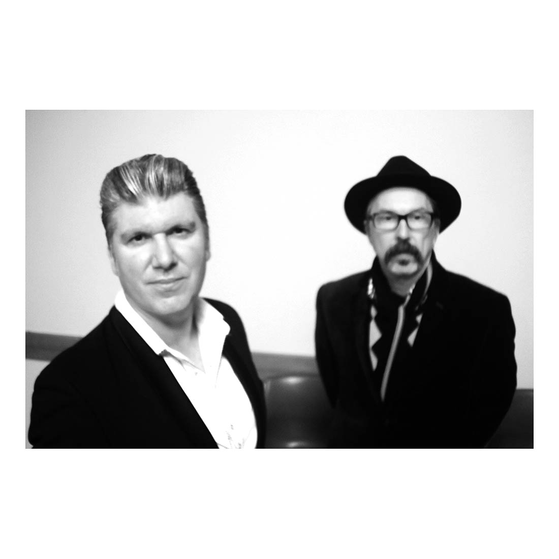 Mikelangelo    and Rob     Snarski    , Turner, ACT, 2016    I did an impromptu photo shoot with Mikel and Rob before a gig they did at the Polish White Eagle Club. I took a lot of photos that night but my favourite was this one, the first shot I took. Unfortunately, being the first shot of the night I hadn't worked out the exposure correctly yet, it was badly overexposed. I tried to correct that but couldn't until I thought of separating the colour channels and found one that had more information in it than the other channels (I think it was the green channel). I was glad I was able salvage this.