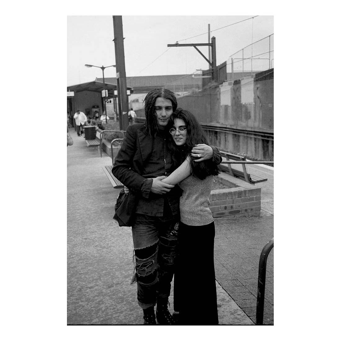 Zoe and her friend, 1996    I first met Zoe at the end of 1994 in Byron Bay. The next year I bumped into her a lot in Newtown and Glebe. She was nice, an interesting soul. This photo was taken at Newtown Station sometime in early 1996. I had just come up from Canberra and had a coffee with her that morning. I haven't seen Zoe since this photo was taken. I don't remember the guy's name.