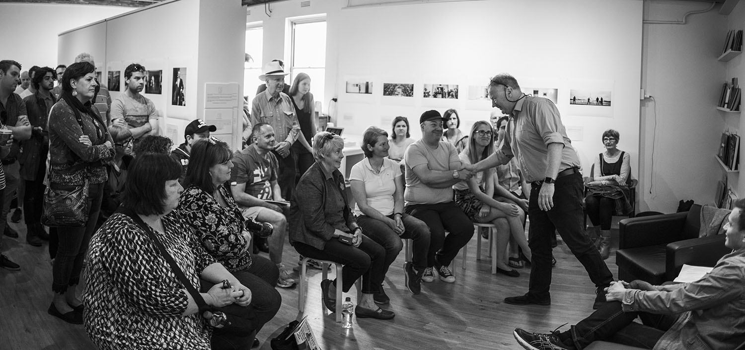Mike Bowers and Alex Ellinghuasen (right, seated) in conversation at TPR Gallery.