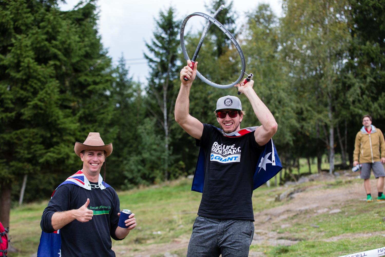 Australian fan (L) and Paul Van Der Ploegh of the Australian MTB Team and former XC Eliminator World Champion