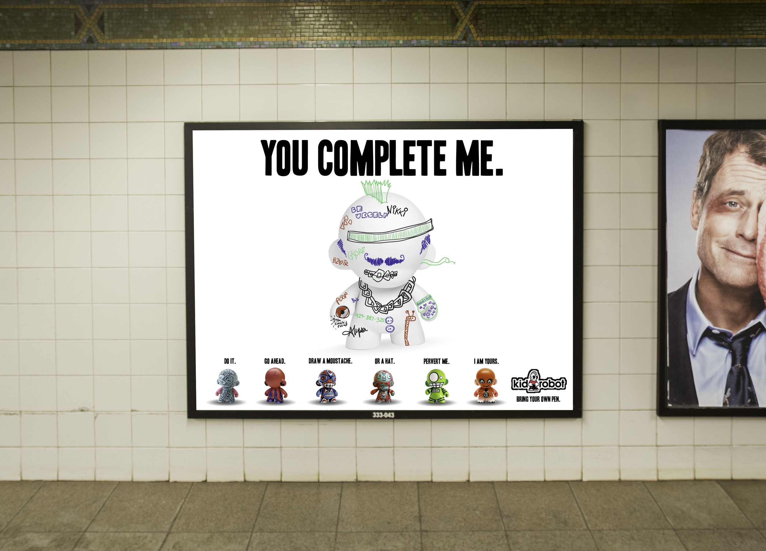 """After a couple of weeks in the subway, the ad is """"completed"""" by its audience."""