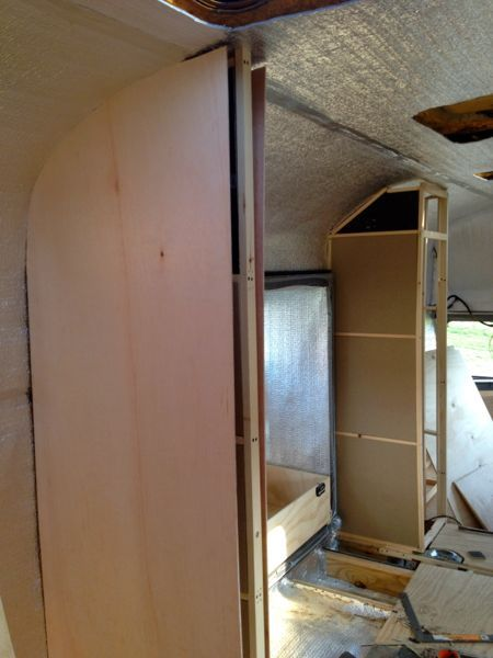 The start of skinning one of the bathroom walls with a lightweight luan board from Builder's Best in Cortland.