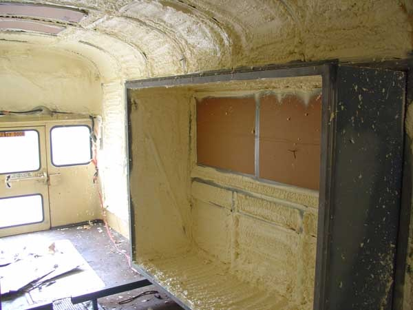 Spray foam in rear slide with window masked off