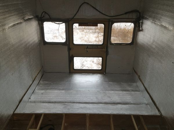 After the foam was in place I installed another layer of Low-E insulation from  K 'n A Distributor s.  There is an air space on each side of the Low-E, similar to the insulation in the walls, and should reflect a majority of any hot or cold air generated by heating or cooling units back into the bus.