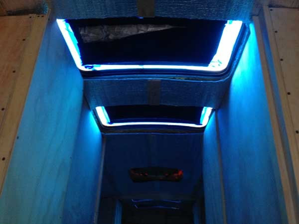 Thanks to the blue masking tape, it felt like the inside of an aquarium on the bus with all the skylights covered.
