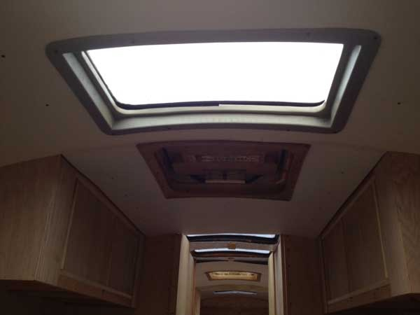 Recycled conversion van window frames for molding around the skylights.
