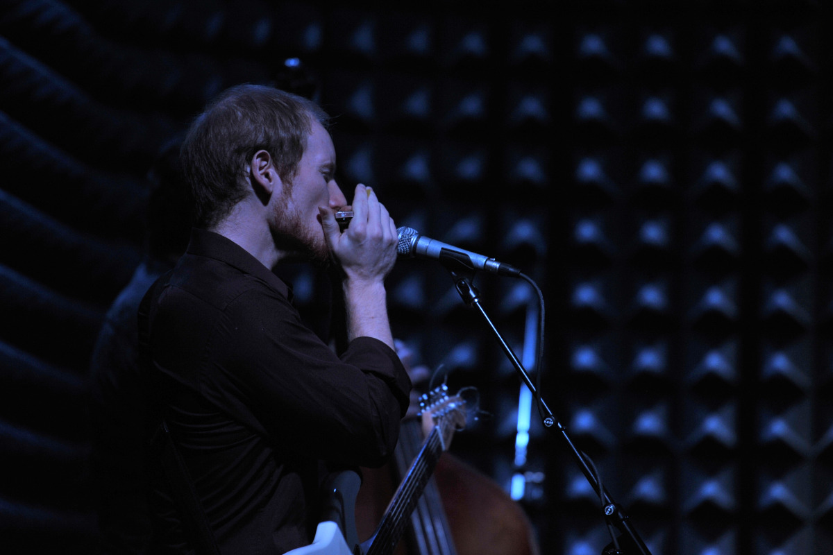 Chris at Joes Pub with harp.jpg