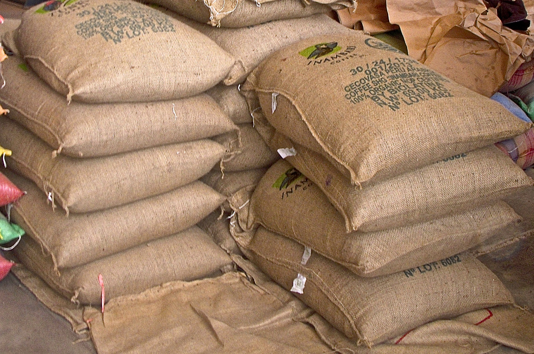 16 huge bags (151 pounds each!) of coffee in a Lima warehouse.