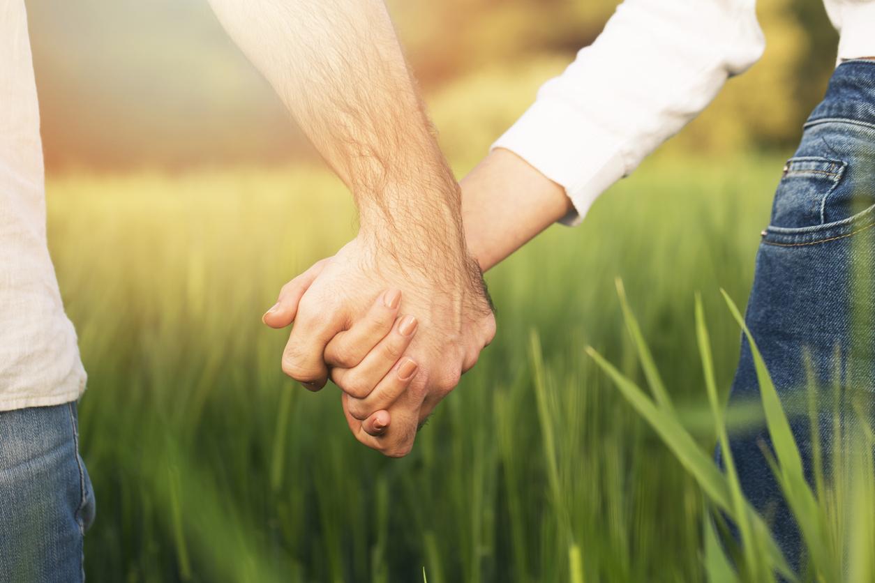 spouses holding hands iStock-522331282.jpg