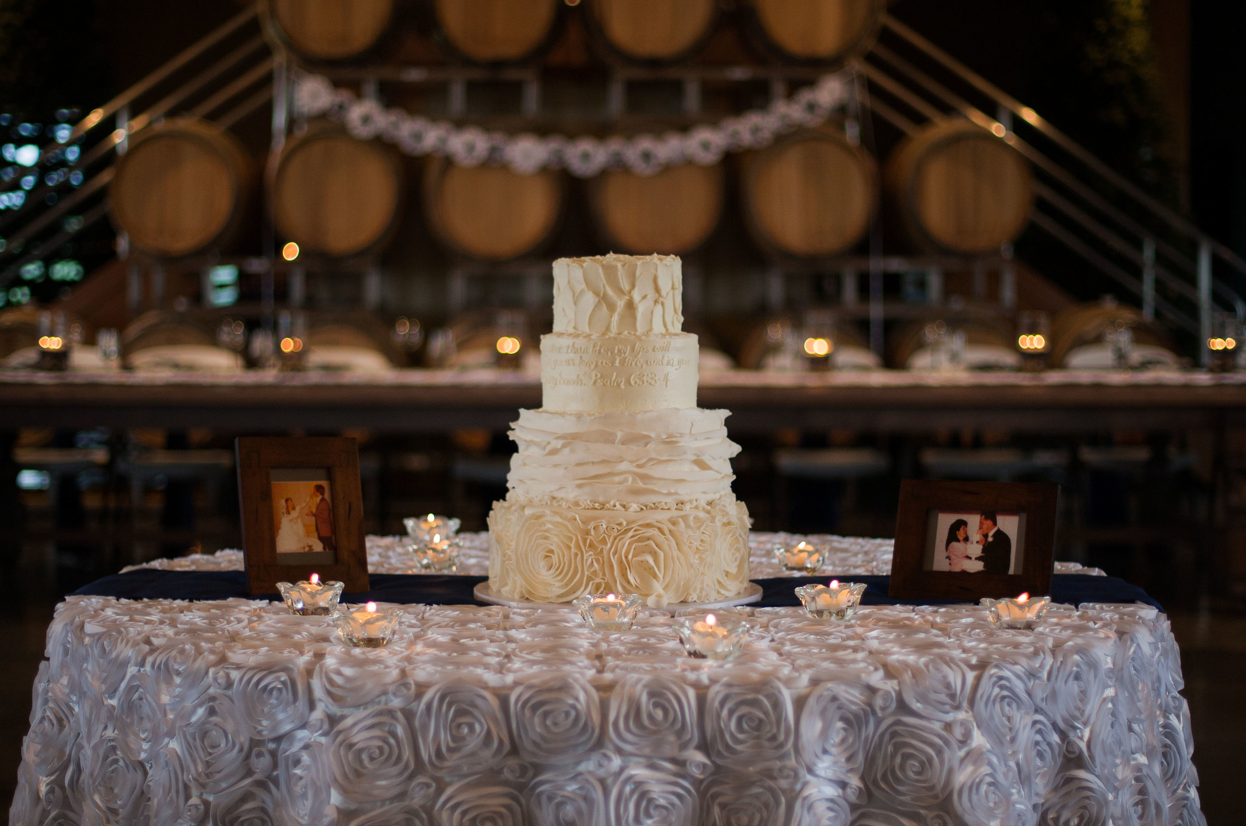 The beautiful wedding cake was white on white with scripture.