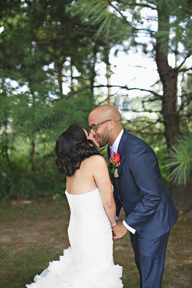 Couple kissing during first look
