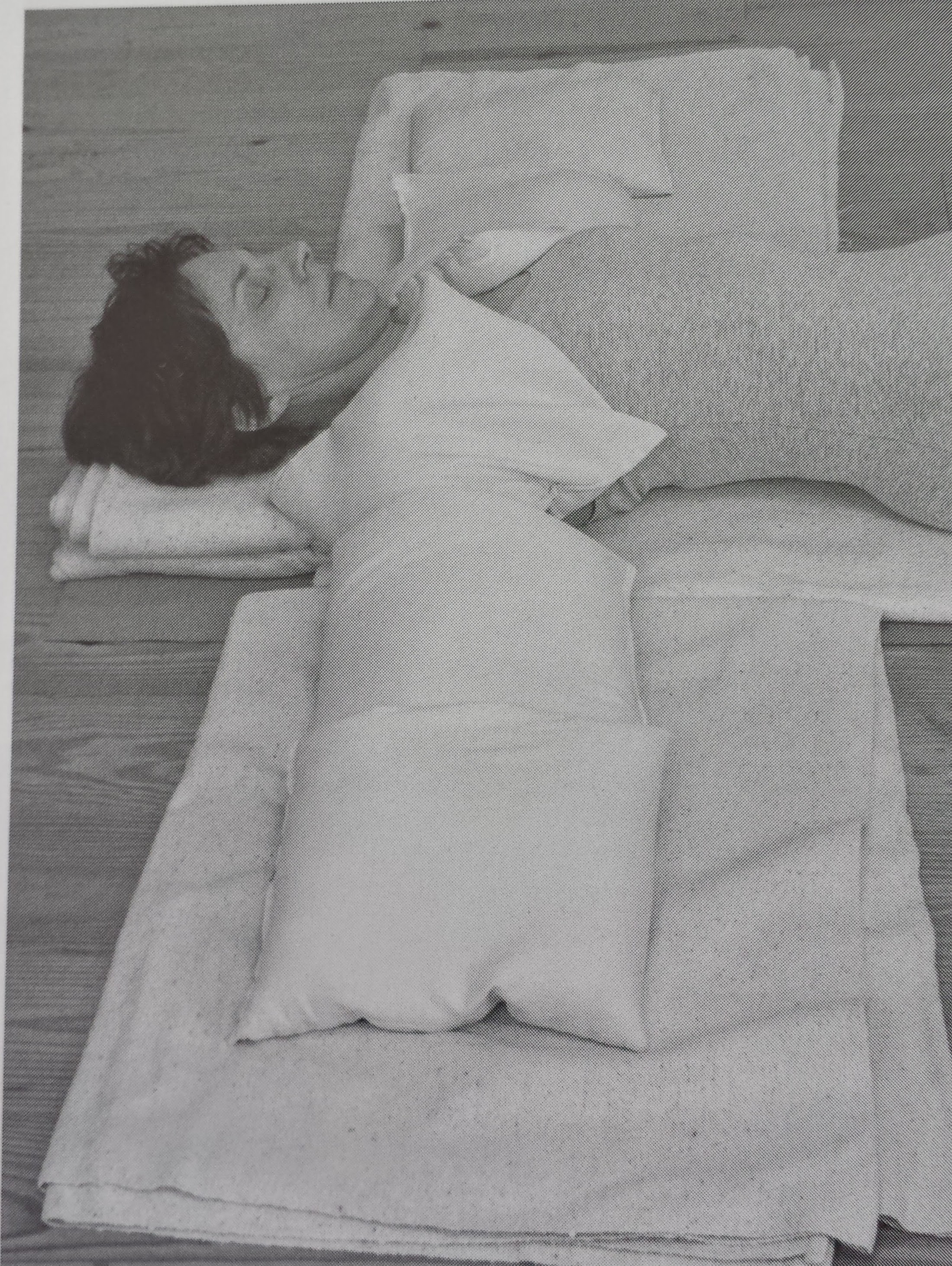 Shoulder Savasana with weights on the shoulders and arms. Sandbags are used here but you can get creative!