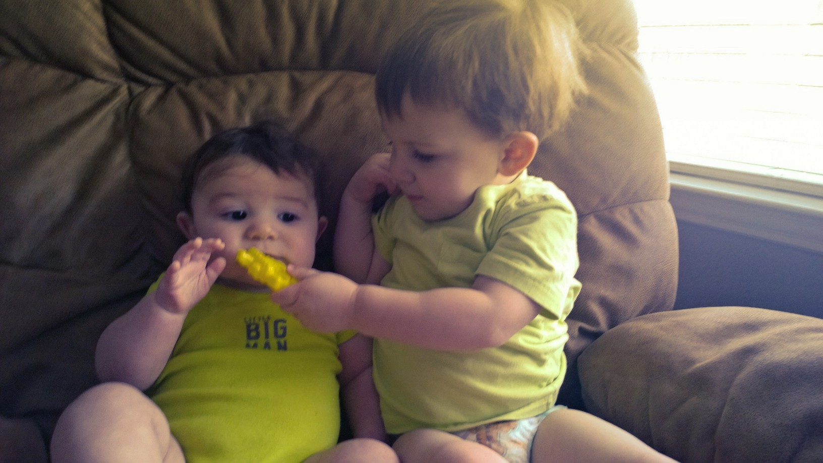 """Noah offering """"fries"""" to Luke...plastic of course."""