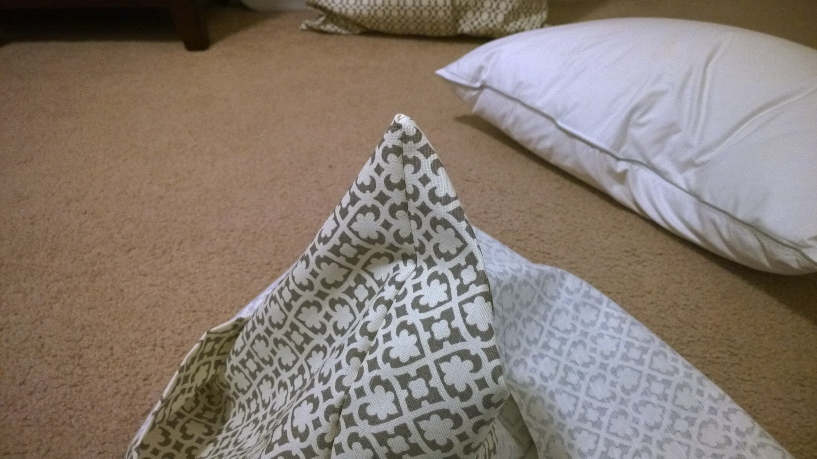 Once all three pieces were sewn, turning the pillow inside out, pressing the corners out to show finished edges
