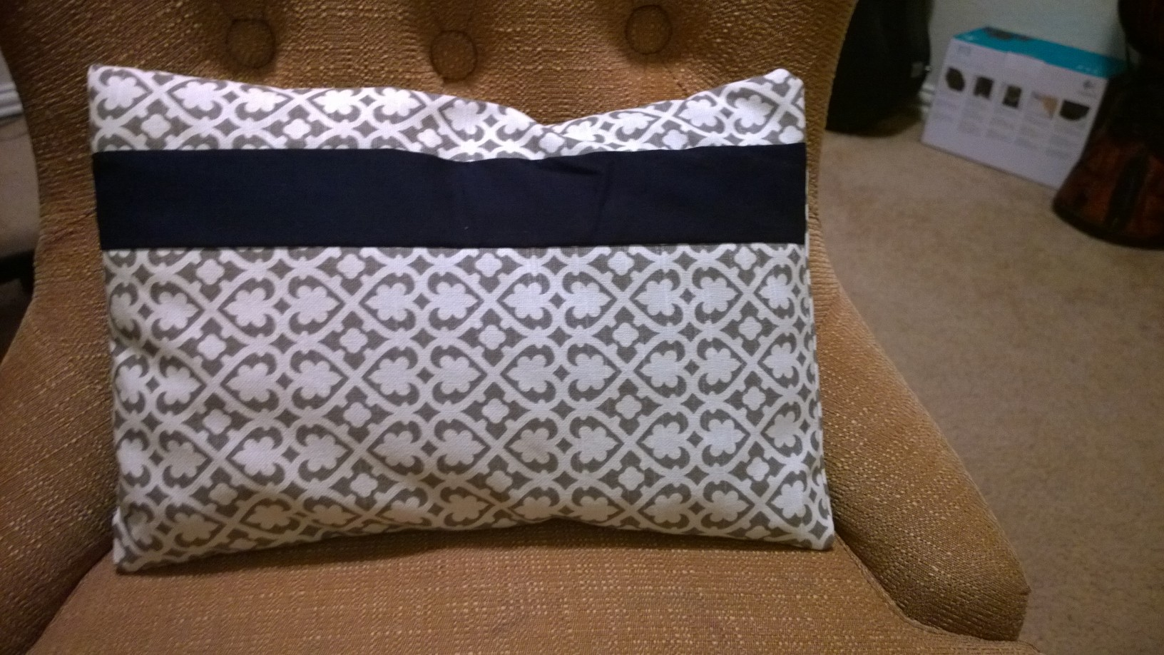 Small decorative pillow, to match the big pillows in the front...