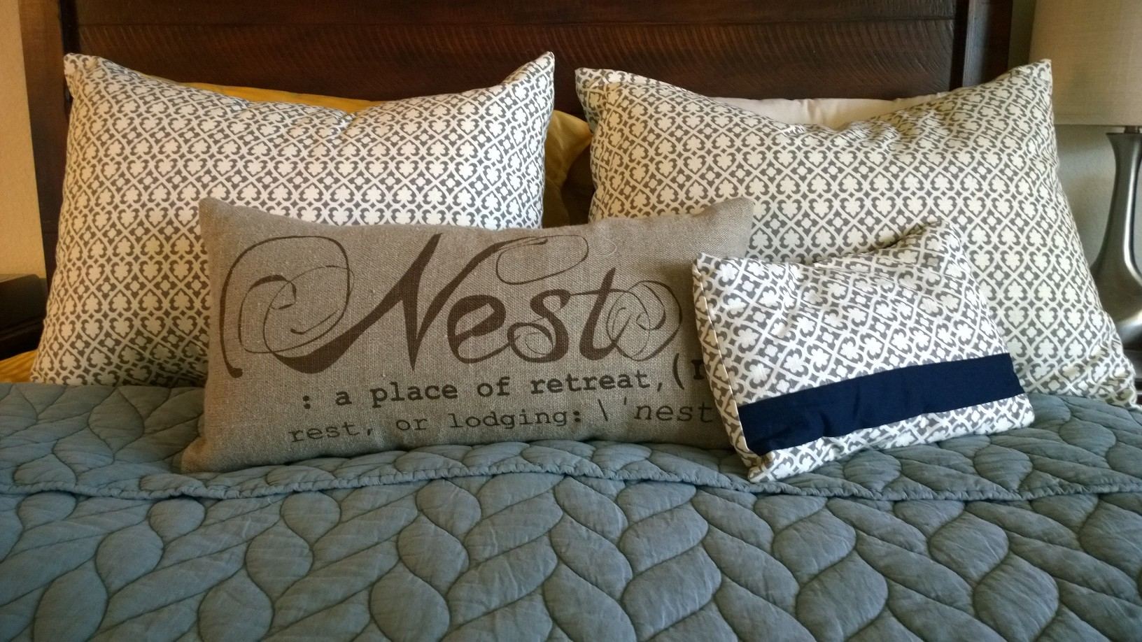 "Final product on the master bed.  The ""nest"" pillow is from Pottery Barn and the Quilt on our bed is from West Elm."