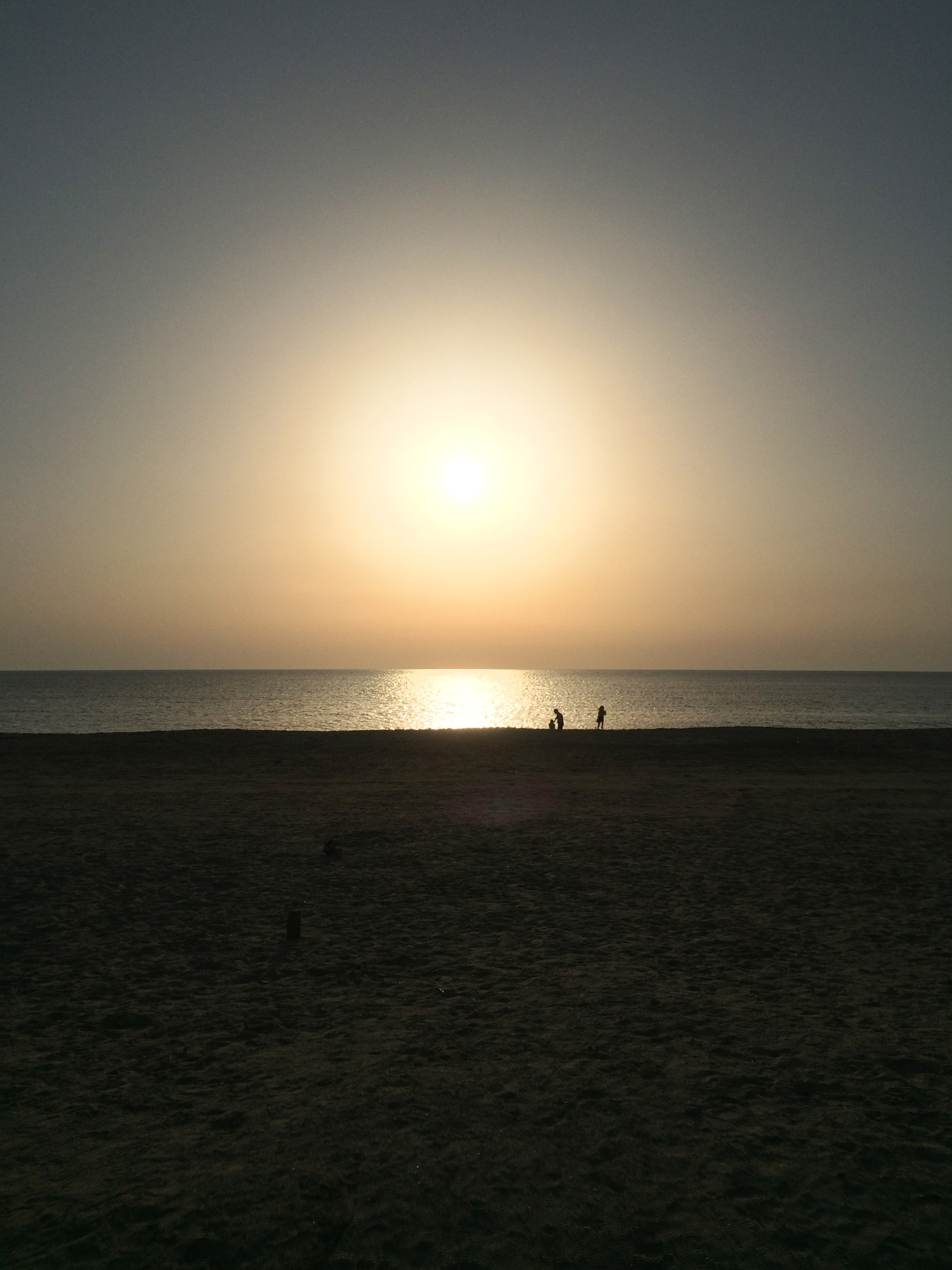 what i will miss: sunset at dukhan beach last month. the girls and i down by the water.  taken by ben