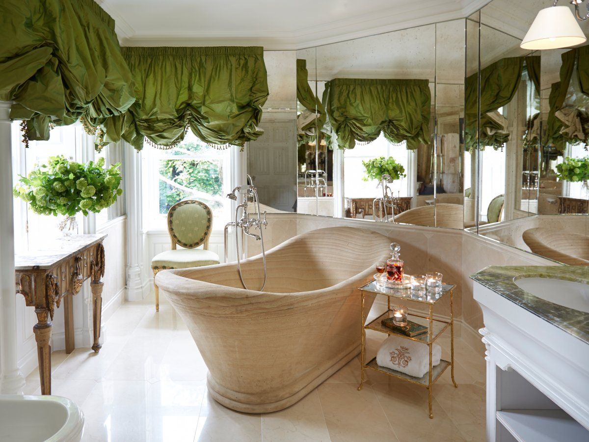 Even the restrooms are elegantly decorated, with deep-sinking tubs, lush curtains, and a place to set your drink while you unwind.