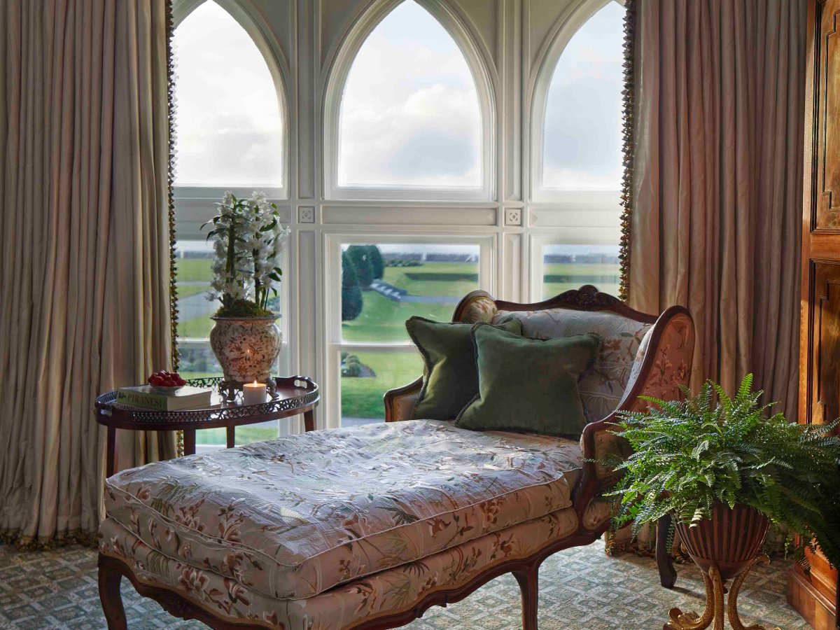 Floor-to-ceiling windows provide views of Lough Corrib, while individually sourced antique furnishings make guests feel like royalty.