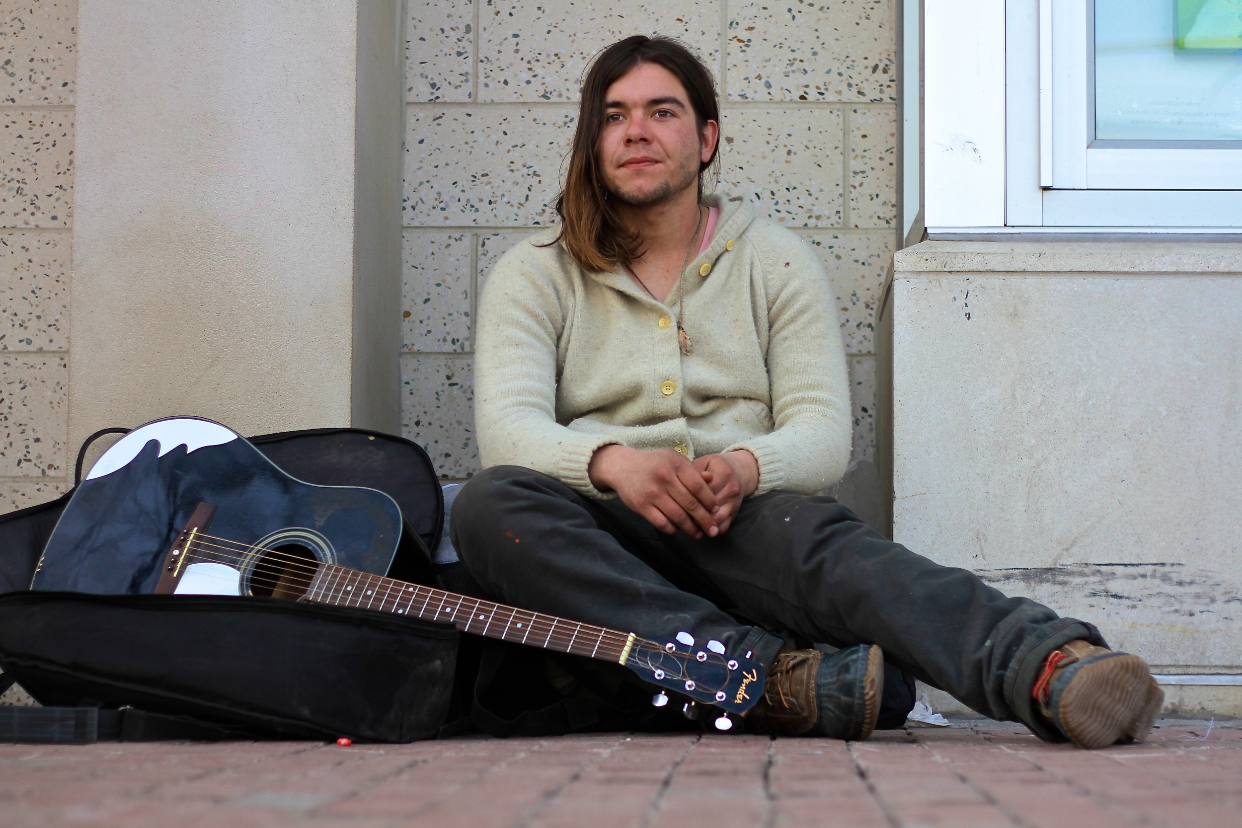 """I met this man in Davis Square. He is from the Bay Area in San Francisco, and he hitchhiked, flew, and carpooled his way to where he is now. Right now he is homeless, but he talked of sleeping, at, quoted, an """"old gay dude's house."""" I asked him what type of music he plays, and he replied with """"my music."""" I liked this answer, because of its simplicity. The name of this post comes from the book, Into the Wild. This man was very similar to Chris McCandless, who was the main character of the story. Similar to McCandless, this man went to a Rainbow Gathering, which are temporary gatherings which is sort of a place for hippies to gather. These Gatherings go against society's values. McCandless stayed at a place called Slab City in California, which has similarities to these Rainbow Gatherings, based on what this man said and my research. I asked him to play me some music, which he did, and he was very talented."""